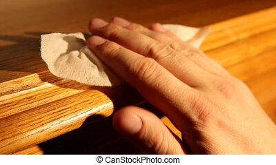 Cleaning furniture - A view of a hand cleaning furniture...