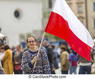 woman on the street holding a flag - Young woman on the...