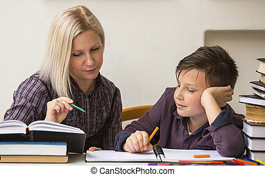 Schoolboy studying with a tutor - Schoolboy studying with...