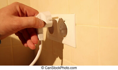 Using a wall electric socket