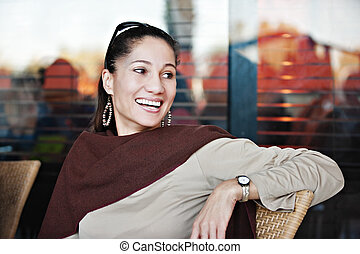 middle age woman - middle age mixed race woman sitting on...