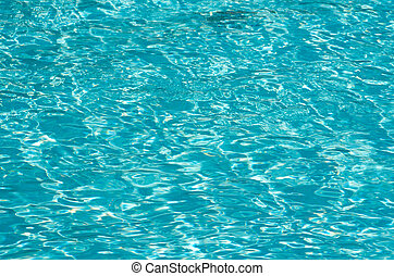 water - Blue pool water with sun reflections