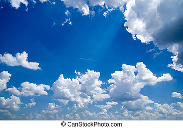 clouds - white fluffy clouds with rainbow in the blue sky