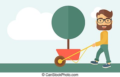 Young man pushing the cart with tree.