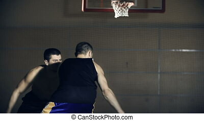 Challenge for the Ball - Tracking shot of two basketball...
