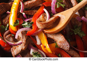 Cooking fajitas: beef with vegetables. macro horizontal -...
