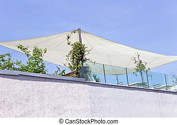 Outside exterior terrace on roof with parasol