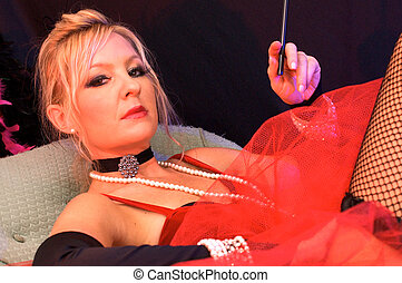 blonde woman in red - Beautiful actress on chaise dressed up...