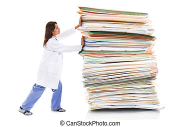 Paper pusher - Stock image of a female healthcare worker...