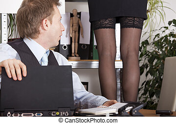 harassment in the workplace - woman in lingerie standing on...