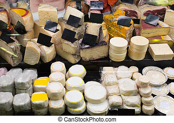 Assortment of fresh European cheese at shop stand