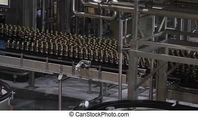 Plastic water bottles on conveyor or water bottling machine