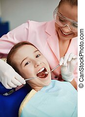 Dental hygiene - Little girl having oral checkup