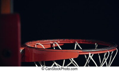 Making a Basket - Side view of basketball going right...