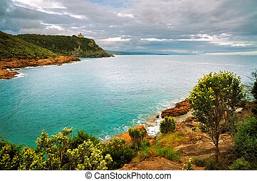 Cliff rock and sea on sunset. Leghorn coast, Tuscany...