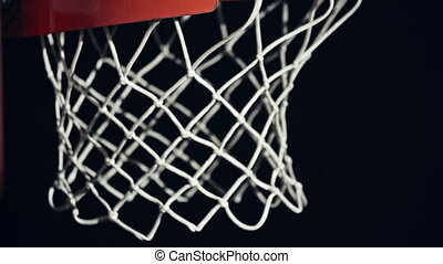 Successful Shot - Macro shot of basketball net letting the...