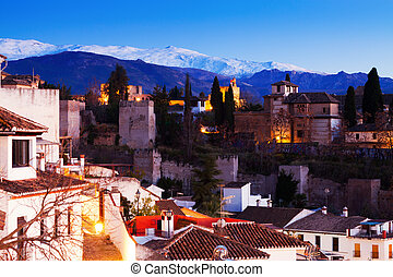 Evening view of Alhambra with Sierra Nevada in Granada -...