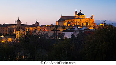 Cathedral of Our Lady of the Assumption and Roman bridge in evening