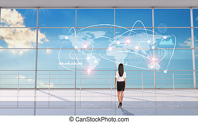 Businesswoman standing back and looking at map