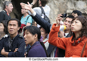 Photographing the Buddhas - Chinese tourists at the Longmen...