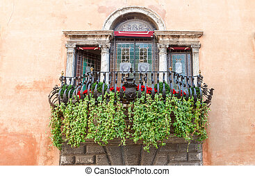 typical decorative balcony in the old town - A typical...