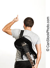 man in casual wear, holding the guitar and standing isolated on white background