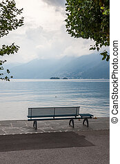 lonely bench overlooking the lake Maggiore - empty lonely...