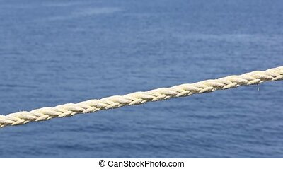 harbor rope - Weathered harbor rope against a blue ocean...