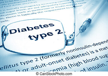 Paper with words diabetes type 2 and glasses