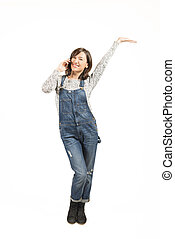 Keep in touch - Full length portrait of a happy young woman...