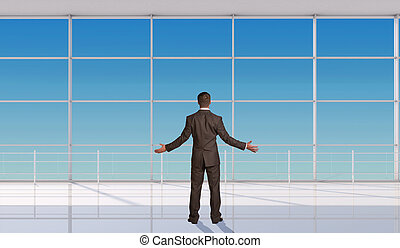 Businessman throwing up his hands in front of window, back...