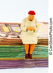 senior sitting on banknotes - figure of an old woman sitting...