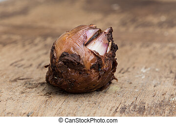 Shallot on brown wooden background