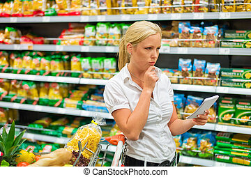 choice in a supermarket - a woman is unable to cope with the...