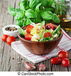 Fresh summer salad with cherry tomatoes, spinach, arugula,...