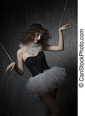 woman with bizarre puppet mask - gothic fashion shoot with...