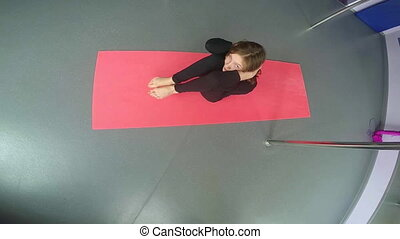 little girl doing sit ups - Little sportive girl exercising...
