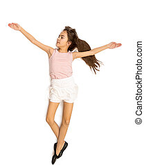 Isolated photo of cute smiling girl in skirt doing ballet...
