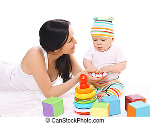 Young mother and baby playing with toys together