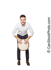 Man playing the djembe standing - Young and handsome guy...