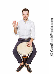 Man playing the djembe - Young and handsome guy playing the...