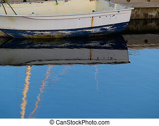 Dinghy reflections. - Dinghy and marina reflections in calm...