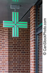 Pharmacy sign - Green cross illumunated pharmacy sign