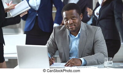 No to Routine - Close up of man signing documents while his...