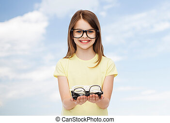 smiling cute little girl in black eyeglasses - people and...