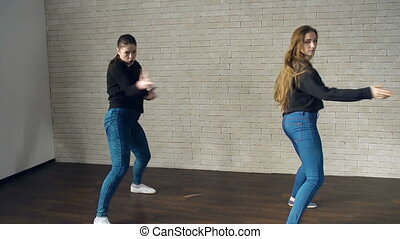 Dancehall Dance - Close up of two young girls dancing at the...