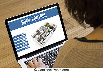 woman computer home automation control - remote control home...