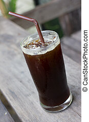 A glass of black iced coffee. - Delicious ice coffee...