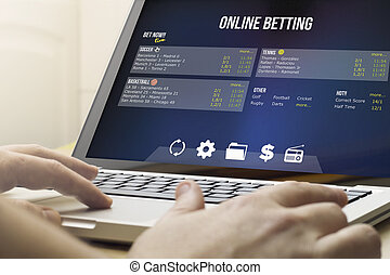 betting online on a laptop - addiction concept: using the...
