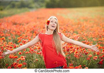 Happy woman on poppy flower field - Lovely woman feeling...